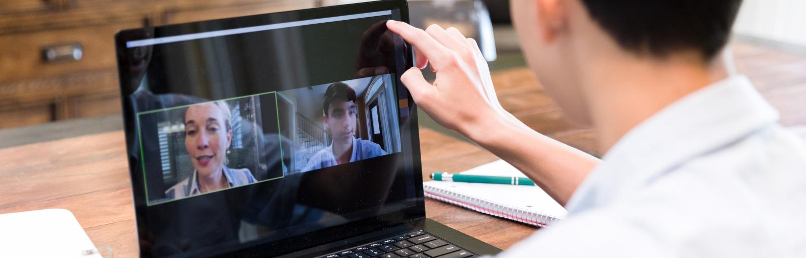 The Catholic School Remote Classroom with male student on remote learning