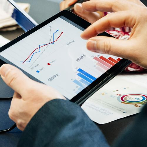 Person reviewing analytics on an iPad
